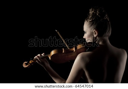 Beautiful, young caucasian violinist playing her violin naked, view from back - stock photo
