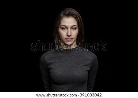 beautiful young caucasian woman portrait on black background - stock photo