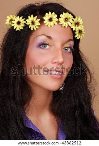 beautiful young caucasian woman with fake flower in hair