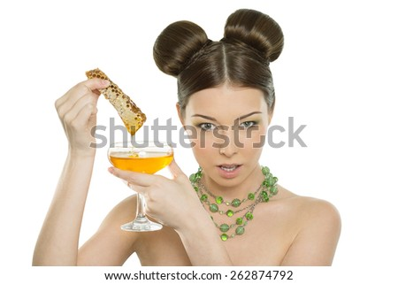 Beautiful young cheerful girl holding honey