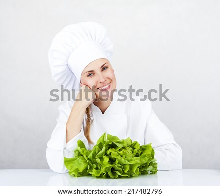 beautiful young chef woman prepare and decorating tasty food vegetable in kitchen - stock photo