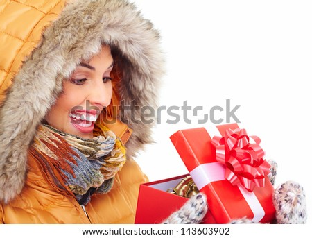 Beautiful young Christmas girl with a gift isolated on white background.