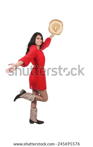 Beautiful young country girl woman wearing a stylish cowboy hat - stock photo