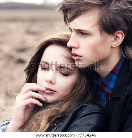 Beautiful young couple close up - stock photo