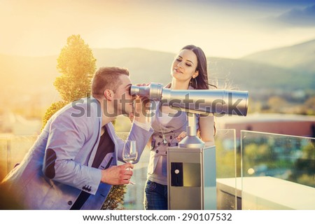 Beautiful young couple drinking wine on a terrace of a bar - stock photo