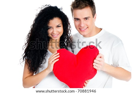 beautiful young couple holding a red heart - stock photo