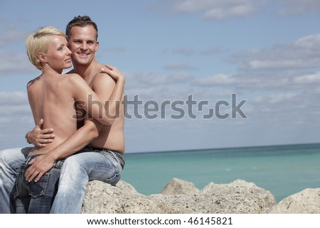 Beautiful young couple holding each other