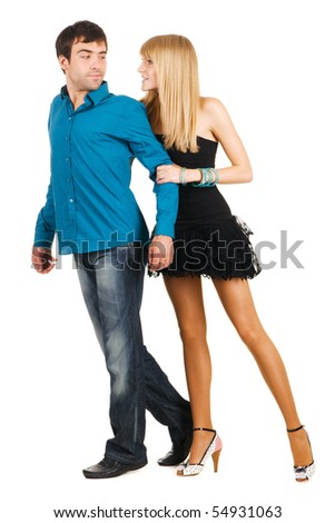 Beautiful young couple in casual clothing, white background