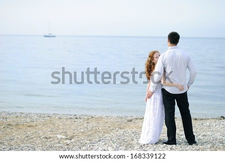 beautiful young couple in love on the beach