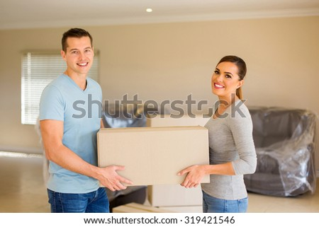 beautiful young couple moving to a new house