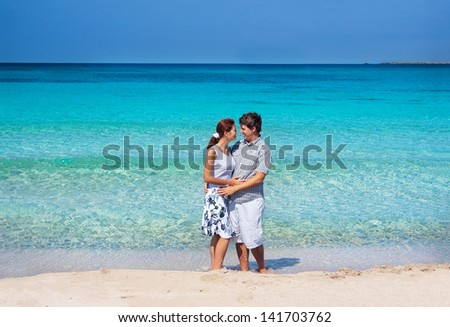Beautiful young couple on a tropical beach