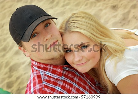 Beautiful young couple on the beach