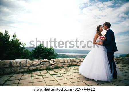 beautiful  young couple posing in the park on a background of nature - stock photo