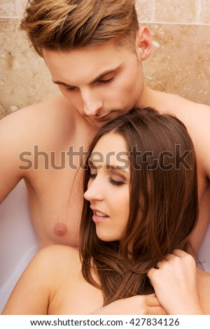 Beautiful young couple relaxing in a bath.