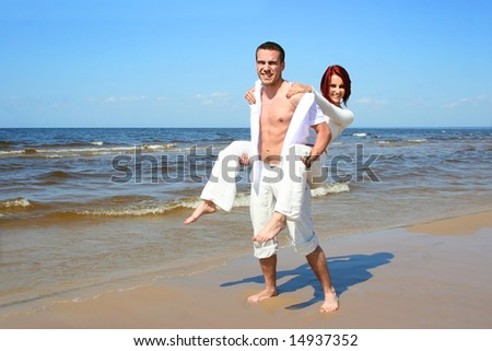 beautiful young couple relaxing on the beach