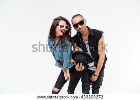 Beautiful young couple standing and having fun together over white background - stock photo