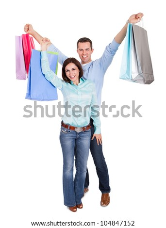 Beautiful young couple with shopping bags. Isolated on white - stock photo