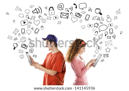 Beautiful young couple with tablets is using social media - stock photo