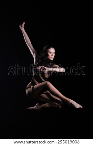 beautiful young  dancer jumping in studio - stock photo