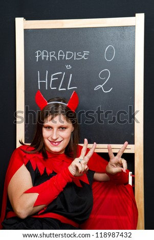 beautiful young devil woman - stock photo