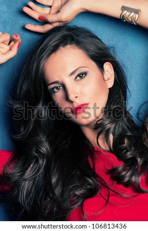 beautiful young elegant woman with perfect long black hair studio shot - stock photo