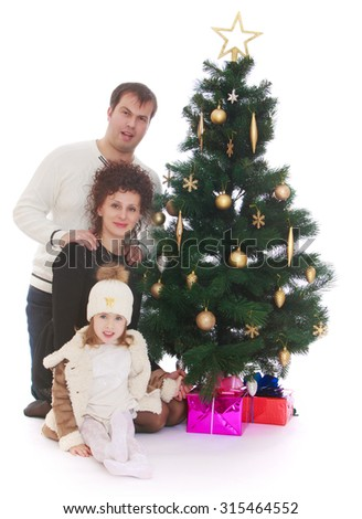 Beautiful young family dad, mom and little charming daughter around the Christmas tree. Next to the Christmas tree are beautifully packaged wrapping paper gift boxes-Isolated on white background - stock photo