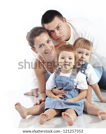 Beautiful young family happy with their kids over white background - stock photo