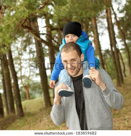 Beautiful young family having fun outdoors - stock photo