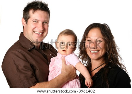 Beautiful young family in casual clothing, father holding bouncing baby girl, isolated on white. - stock photo