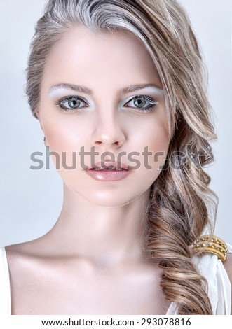 Beautiful young fashion model with winter ice style makeup - stock photo