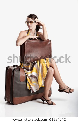 Beautiful young fashion woman posing with a old suitcase - stock photo