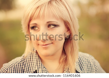 Beautiful young fashionable girl with makeup in the rays sun