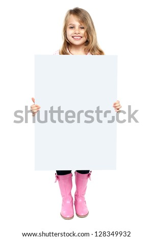 Beautiful young female child displaying blank ad board, business concept.