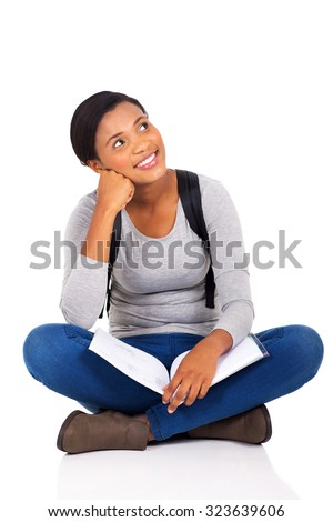 beautiful young female college student looking up on white background - stock photo