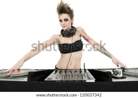 Beautiful young female DJ wearing strapless lingerie over white background - stock photo