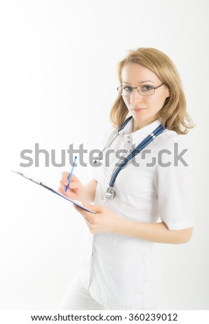 beautiful young female doctor in medical gown and rubber gloves holding a medical records. nurse making entries medical records - stock photo