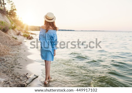 beautiful young female enjoying a day at the beach - stock photo