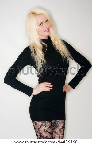 Beautiful young female in black - stock photo