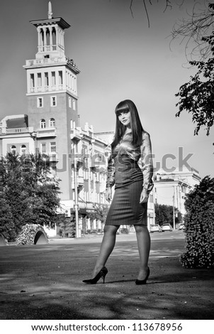 Beautiful young female in street scene - stock photo