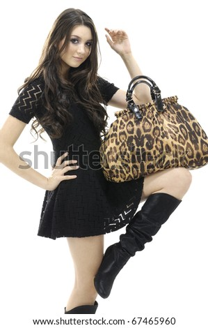 Beautiful Young Female Model holding bag posing - stock photo