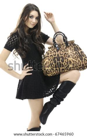 Beautiful Young Female Model holding bag posing - stock photo