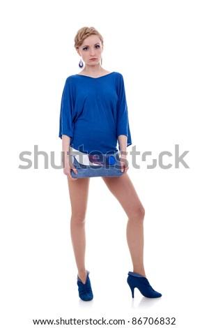 Beautiful Young Female Model holding bag posing on white background - stock photo