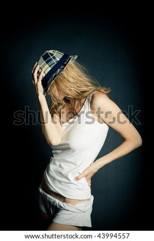 Beautiful Young  Female Model in Studio  with hat - stock photo