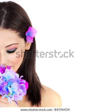 Beautiful young female portrait, hand holding a purple flower, isolated on white background with white text space, beauty and spa concept - stock photo