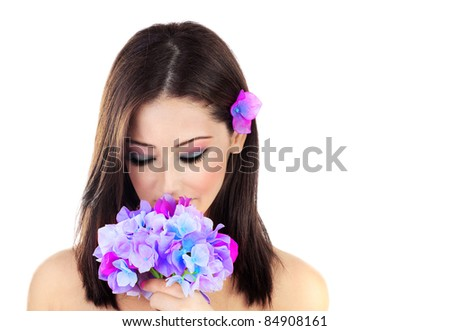 Beautiful young female portrait, holding a purple flower, isolated on white background with white text space, beauty and spa concept - stock photo