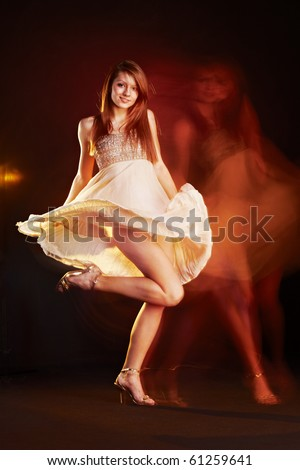 Beautiful young female wearing dress, dancing, multiple exposure non photoshoped montage. - stock photo