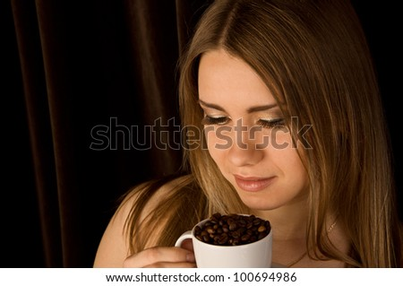 Beautiful young female with a coffee cup - stock photo