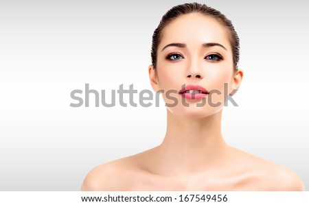 Beautiful young female with clean fresh skin - stock photo