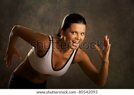 Beautiful young fitness woman in run . - stock photo