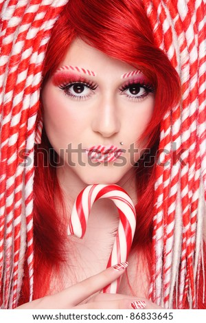Beautiful young freaky girl with fancy make-up and hairdo - stock photo